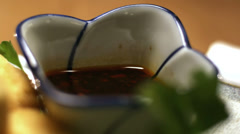 Close up of soy sauce dip and fried tofu. Close up shot. - stock footage