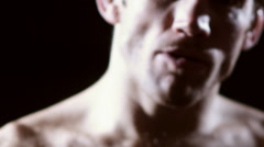 Mixed martial arts athlete removes his mouth protection. Close up shot. Stock Footage