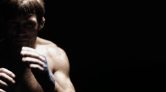 Mixed martial arts athlete shadow boxes in front of camera. Close up shot. Stock Footage