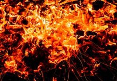 Stock Photo of abstract background. burning charcoals with sparks