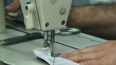 Stock Video Footage of Machinist sewing