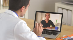 Doctor talking to patient through the internet Stock Footage