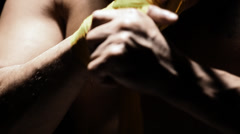 Mixed martial arts athlete tapes is hands with yellow fabric. Close up shot. Stock Footage