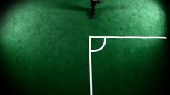 Soccer athlete kicks a corner kick. Wide shot as seen from above Stock Footage