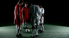 Soccer player prepares for a corner kick, then kicks the ball. - stock footage