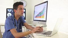 Mexican medical researcher analyzing data Stock Footage
