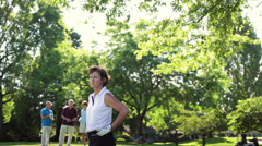A woman golfer looks down the course upset with her shot. Stock Footage