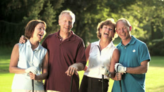 A group of older golfing buddies stand next to each other for a portrait Stock Footage