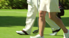 A group of old friends meet on the golf course and say hello Stock Footage