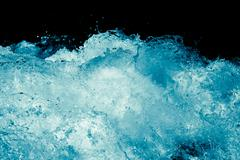 abstract background. rough water with splashes - stock photo
