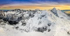 panoramic view of winter mountains at colorful sunset - stock photo