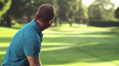 Male golfer tees off with his driver Stock Footage