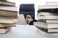 Stock Photo of overwhelmed reading books
