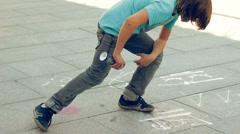 Teen Boy Spray Painting Graffiti Art on Street HD Stock Footage