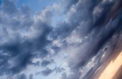 Beautiful clouds at sunset as background Stock Photos