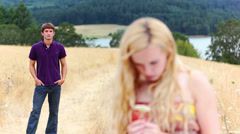 Young woman is upset with boy standing in the background. Stock Footage