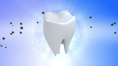 Tooth. Rotate tooth in blue background Stock Footage
