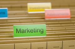 hanging file folder labeled with marketing - stock photo