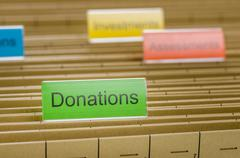 hanging file folder labeled with donations - stock photo