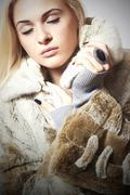 Stock Photo of Beautiful blond woman Girl in Mink Fur Coat.winter fashion