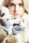 Stock Photo of Beautiful blond woman in Fur Coat.Winter fashion.