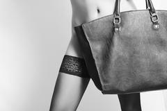 Art photo of sexy woman with handbag.stockings Stock Photos