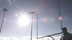 A football referee raises hands over his head for a field goal Stock Footage