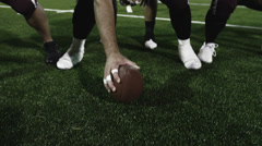 Football players lining up and snapping the ball and then running Stock Footage
