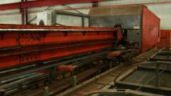 Machine Carrying Steel Bars Stock Footage