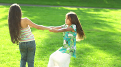 Cute little girls twirl each other around. - stock footage