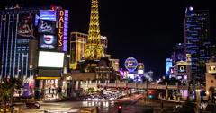 4K time lapse of Ballys and Paris casinos and the Las Vegas strip Stock Footage