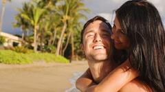 Attractive mid adult couple look at the camera and smile. Medium shot. Stock Footage