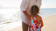 Little girl rides on her fathers shoulder. Stock Footage