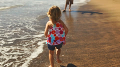 Father and daughter embrace at the beach. - stock footage