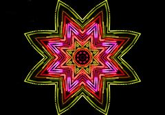 bright color star on black - stock illustration