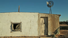 Abandoned Desert Ranch Adobe House with Windmill - stock footage