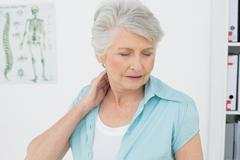 Senior woman suffering from neck pain Stock Photos