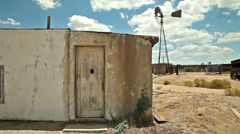 Abandoned Desert Ranch Adobe House with Windmill Stock Footage