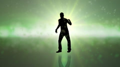 Silhouette dancer on green struts his stuff on a colorful background - stock footage