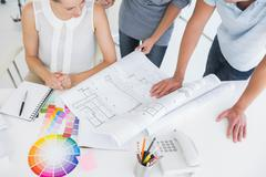 Mid section of artists working on designs - stock photo