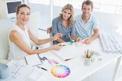 Group of artists working on designs - stock photo