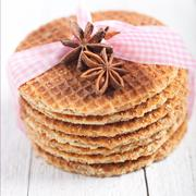 waffles with star anise and a decorative ribbon - stock photo