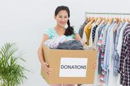 Stock Photo of Young woman with clothes donation