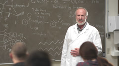 A professor gives a lecture to his class - stock footage