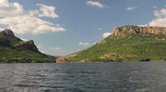 Beautiful mountain lake fly-through Stock Footage
