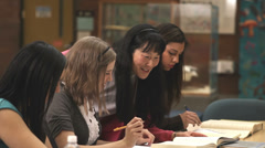 A group of college students work together to finish an assignment - stock footage