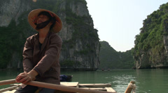 Vietnamese guy rowing the boat with tourist - stock footage