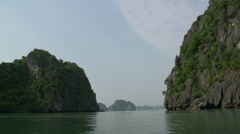 Sailing through the mountains in Ha Long Bay Stock Footage
