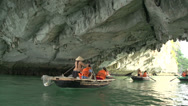 Stock Video Footage of Tourists in a boat trip under the gap of a mountains in Ha Long Bay