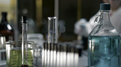 Close up shot of chemistry equipment set up on a laboratory table - stock footage